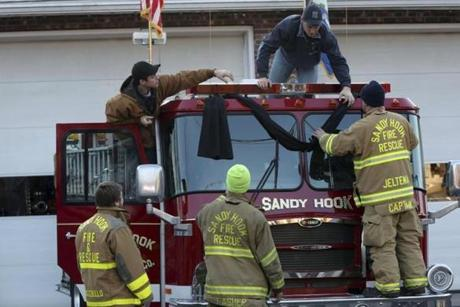 Sandy Hook firefighters hung bunting on their firetruck.